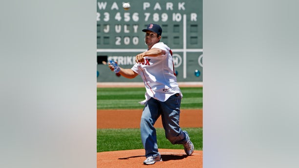 Mark Wahlberg throws out a ceremonial first pitch before the Red Sox play a game against Seattle at Fenway Park in 2009.