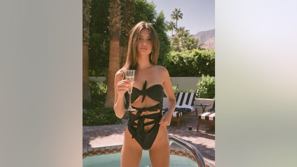 """Model and former """"Blurred Lines"""" star Emily Ratajkowski showcased a very revealing swimsuit for a sultry social media snap. For more photos of Ratajkowski, visit <a data-cke-saved-href=""""https://hollywoodlife.com"""" href=""""https://hollywoodlife.com"""">HollywoodLife.com</a>."""
