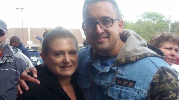 "Maria Lisante, the owner of La Bella Pizza Bistro in New Paltz, New York, with her friend, Joey Garcia, a New York state corrections officers and veteran, who organized the ""American flag appreciation walk"" Sunday in support of the American flag mural at her business."