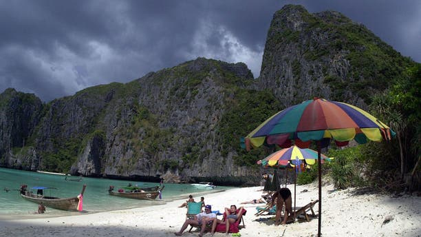 "Tourists catch the sun's rays on remote Maya Bay in southern Thailand, made famous as the shooting location of the Leonardo DiCaprio movie, ""The Beach."""