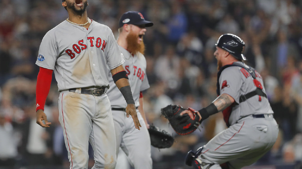 FILE: Boston Red Sox third baseman Eduardo Nunez, left, celebrates with teammates after the Red Sox victory in New York.