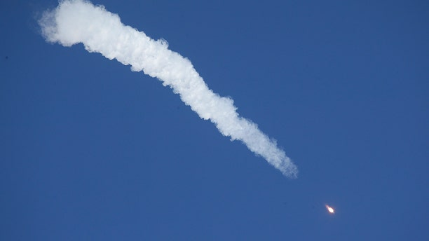 The Soyuz-FG rocket booster with Soyuz MS-10 space ship carrying a new crew to the International Space Station, ISS, flies in the sky at the Russian leased Baikonur Cosmodrome, Kazakhstan.