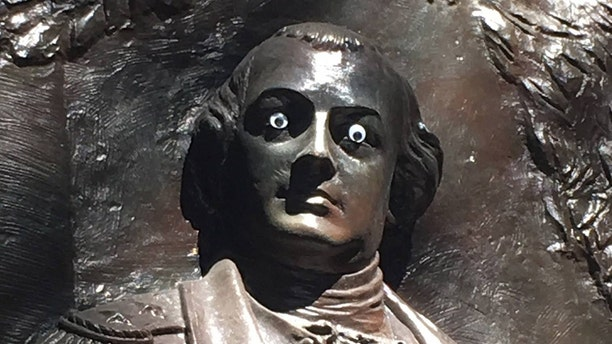 """Someone has put """"googly eyes"""" on a statue of Revolutionary War General Nathanael Greene in Savannah's Johnson Square."""