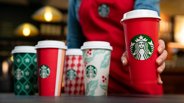 The new cups, along with a limited edition reusable cup (right), will be available starting Nov. 2.
