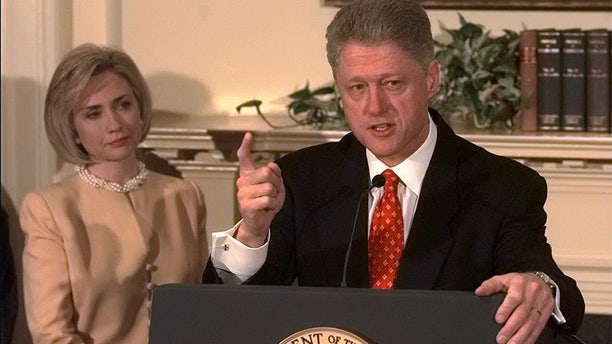"""President Bill Clinton shakes his finger as he denies improper behavior with Monica Lewinsky, in the White House Roosevelt Room. """"I did not have sexual relations with that woman,"""" Clinton said. First Lady Hillary Rodham Clinton stands by her man."""