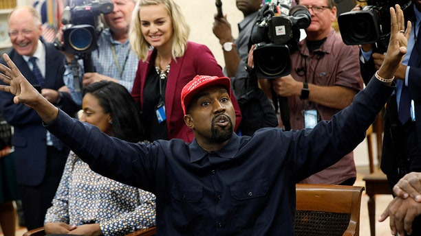 Rapper Kanye West speaks during a meeting with U.S. President Donald Trump in the Oval Office of the White House in Washington, U.S., October 11, 2018. REUTERS/Kevin Lamarque - RC1247601DF0