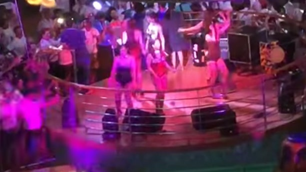 Concerned families said they were forced to stay inside to avoid the barely-dressed women dancing on the ship's deck.