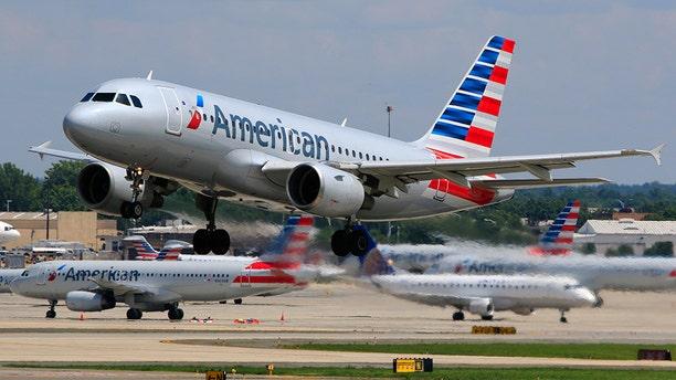 American Airlines spokeswoman Leslie Scott says the e-cigarette's battery overheated.