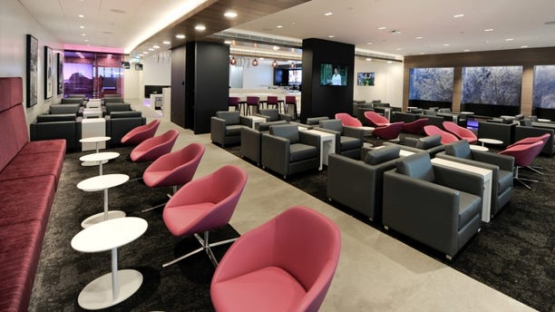 A woman is outraged after being removed from Air New Zealand's Koru Lounge.