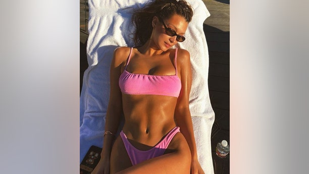 """Bella Hadid, who recently rang in her 22nd birthday, enjoyed a day in the sun in a bubblegum-pink bikini. """"Just a few more minutes of Vitamin D before the cold please,"""" the model captioned her sexy pic."""