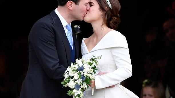Princess Eugenie and Jack Brooksbank kiss after their wedding.
