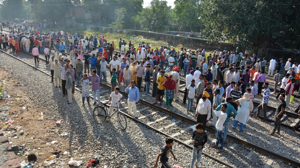 A crowd gathers at the site of Friday's train accident in Amritsar, India, Saturday, Oct. 20, 2018. A speeding train ran over a crowd watching fireworks during a religious festival in northern India on Friday evening, killing more than 50 people and injuring dozens more, police said.