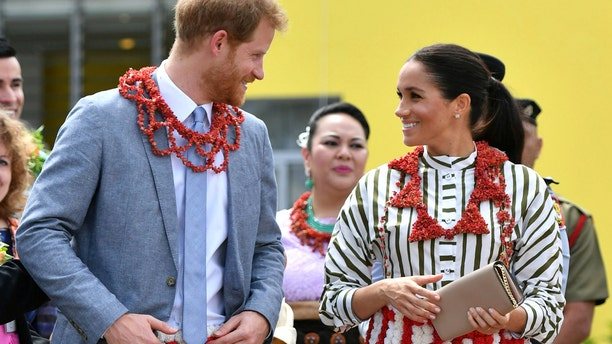 The Duke and Duchess of Sussex visit an exhibition of Tongan handicrafts, mats and tapa cloths at the Fa'onelua Convention Centre in Nuku'alofa, Tonga, Friday, Oct. 26, 2018.