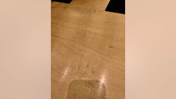 Photos obtained by Fox News show damage to the desks by delegates.