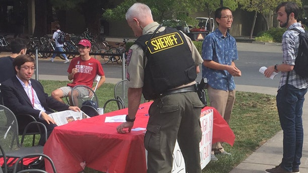 """The police were called during a """"Change My Mind"""" event supporting Justice Kavanaugh Tuesday at Stanford University."""