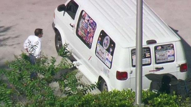Authorities in Florida investigate a van believed to belong to the suspect