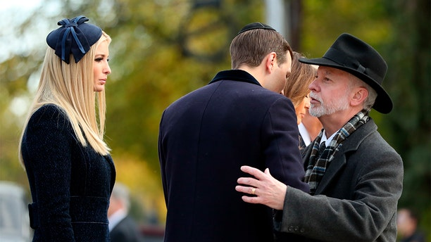 Jared Kushner, center, and Ivanka Trump, left, greet Tree of Life Rabbi Jeffrey Myers, right, as they arrive with President Donald Trump and first lady Melania Trump outside Pittsburgh's Tree of Life Synagogue in Pittsburgh, Tuesday, Oct. 30, 2018. (AP Photo/Andrew Harnik)