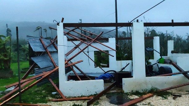 Damage from Super Typhoon Yutu is shown outside Glen Hunter's home in Saipan, Commonwealth of the Northern Mariana Islands, Thursday. (Glen Hunter via AP)