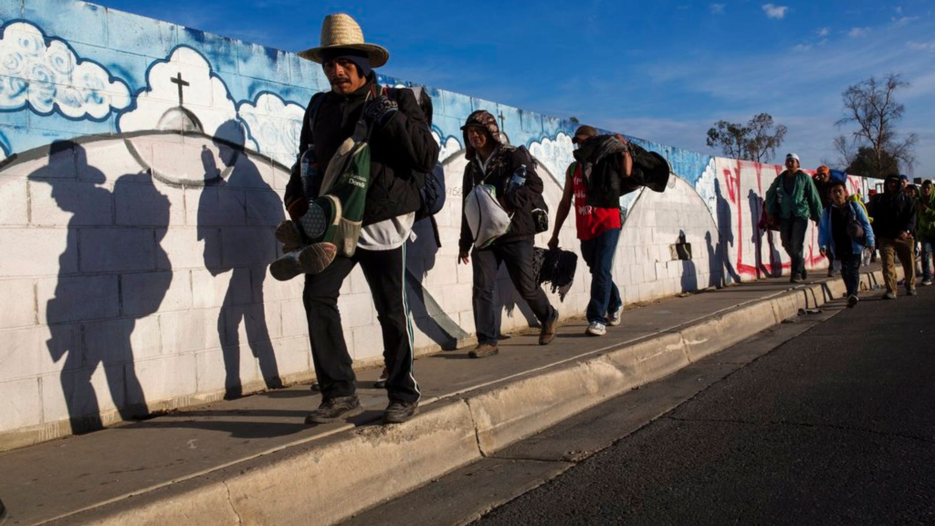 Migrants, who are part of a Central American migrant caravan, leave Mexicali for Tijuana, Mexico.