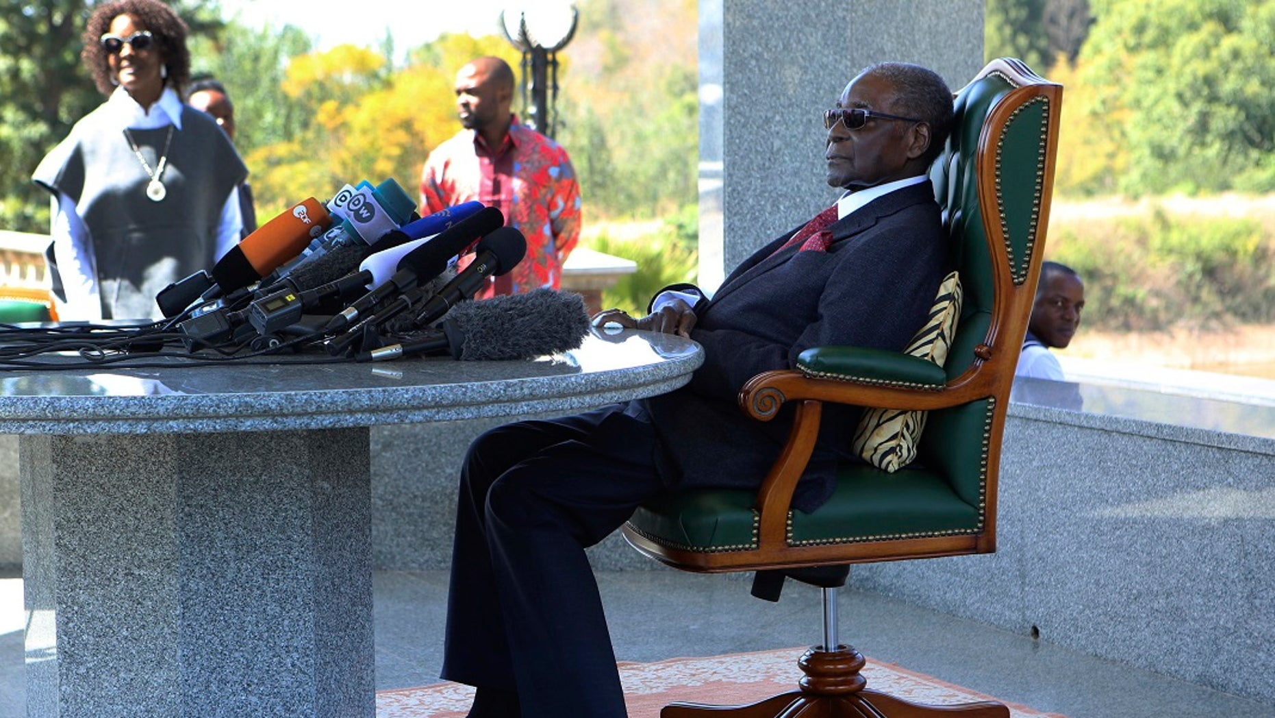 Former Zimbabwean President Robert Mugabe holds a press briefing at his residence in Harare.
