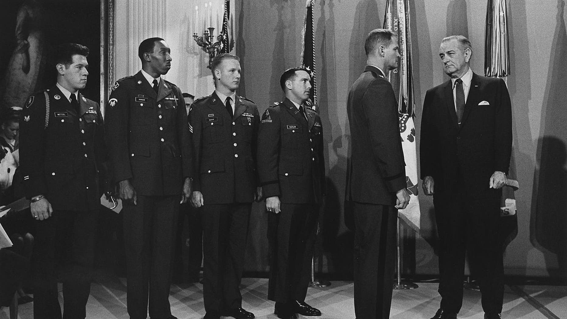 Maj. James Allen Taylor waiting to get his Medal of Honor from President Johnson