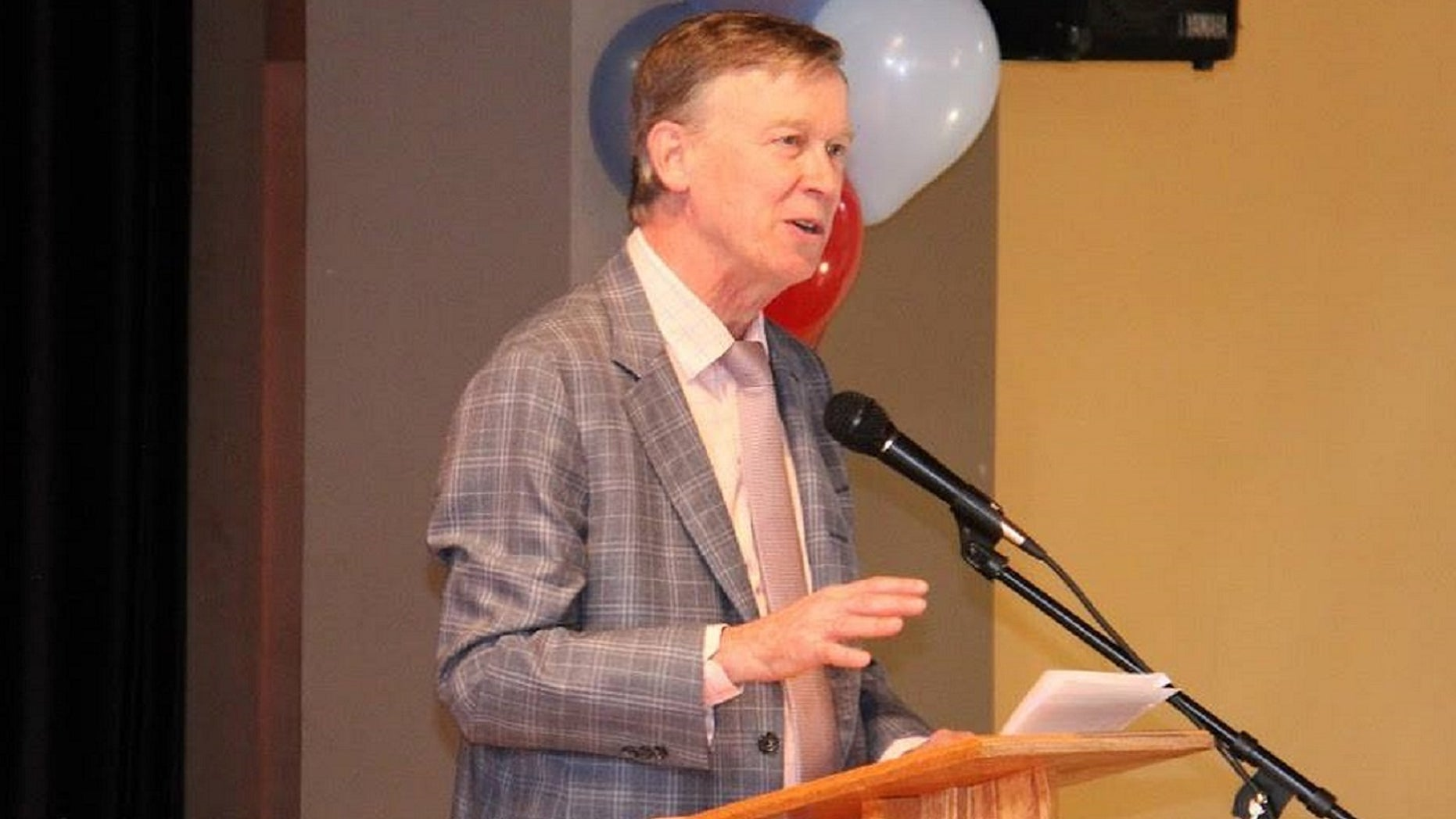 Colorado Gov. John Hickenlooper granted 23 people clemency, reports said Friday.