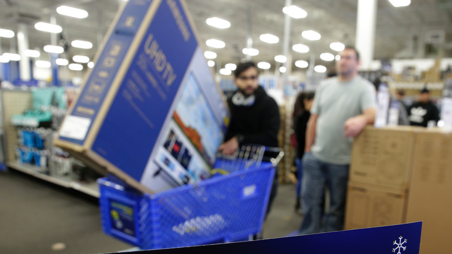 95fe68409e1 People wait in line to buy televisions as they shop during an early Black  Friday sale