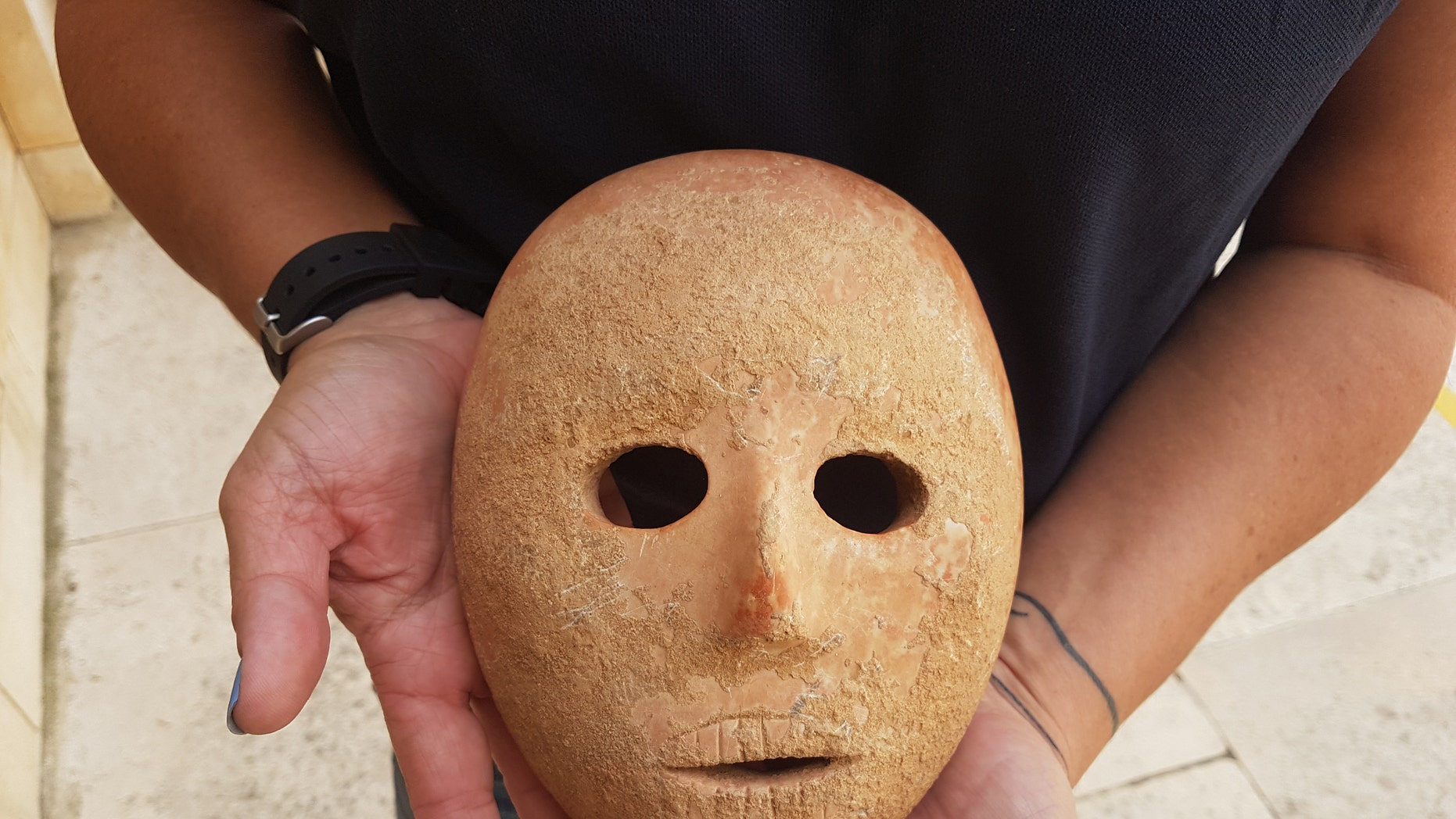 The ancient mask was discovered on the West Bank. (Antiquities Theft Prevention Unit, Israel Antiquities Authority)<br><br>