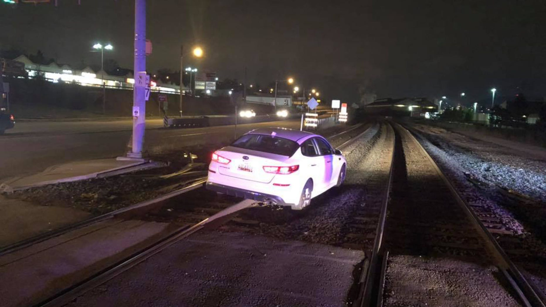 A woman says she followed her GPS, which led her to drive onto train tracks.