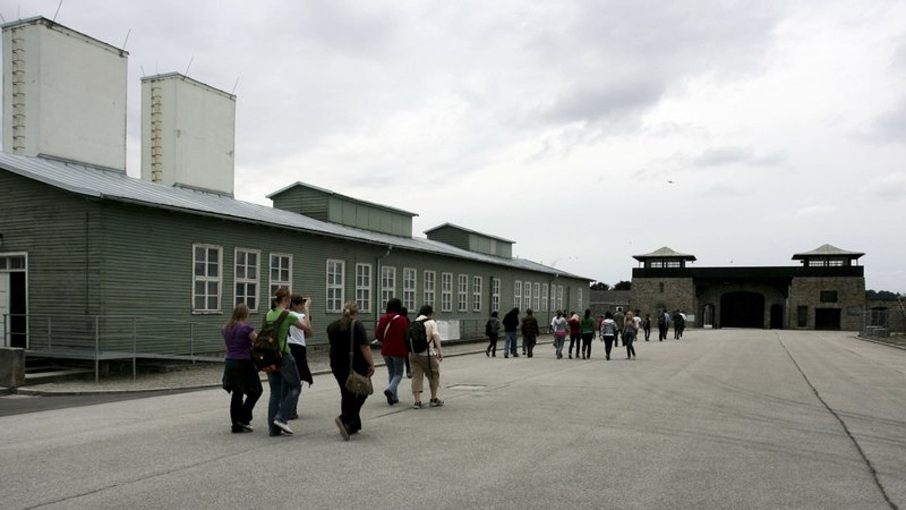 In this June 17, 2008 file photo, young people and participants of a conference of the Task Force for International Cooperation on Holocaust Education, Remembrance and Research visit the former Nazi concentration camp in Mauthausen, Austria.