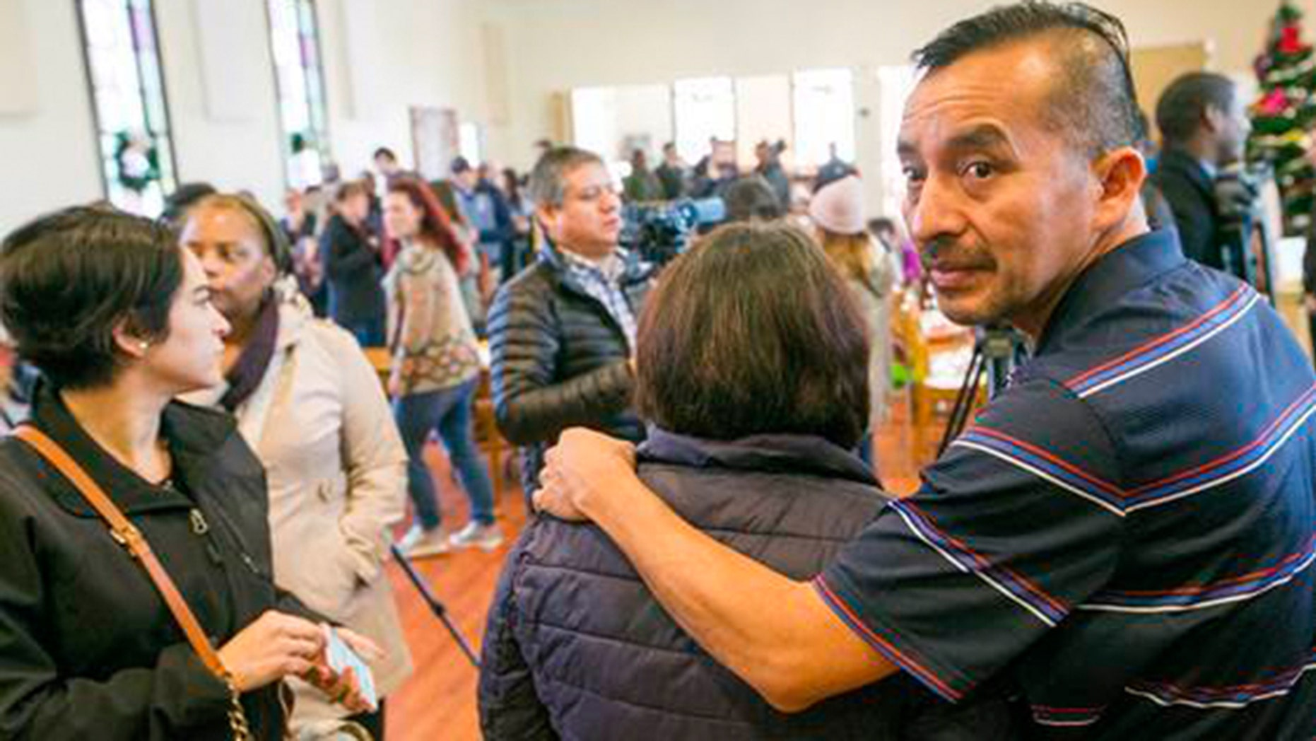 In this Dec. 13, 2017, photo Samuel Oliver-Bruno glances back before preparing for interviews after the press conference held at CityWell United Methodist Church in Durham, N.C. Oliver-Rruno, who sought refuge from deportation at the church for 11 months was arrested Friday after arriving at an appointment with immigration officials. (Casey Toth/The Charlotte Observer via AP)