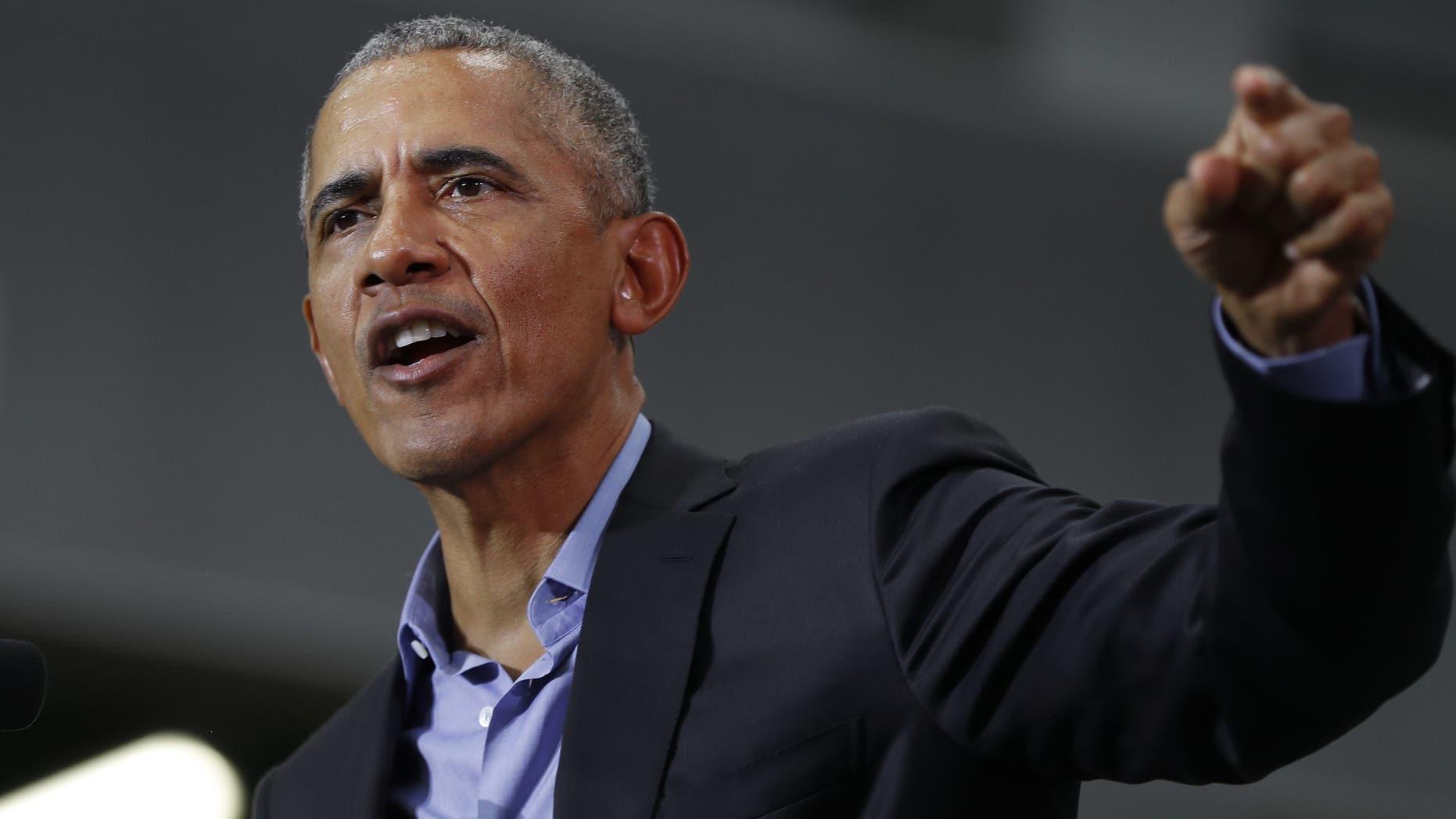 Former President Barack Obama, (AP Photo/Paul Sancya)