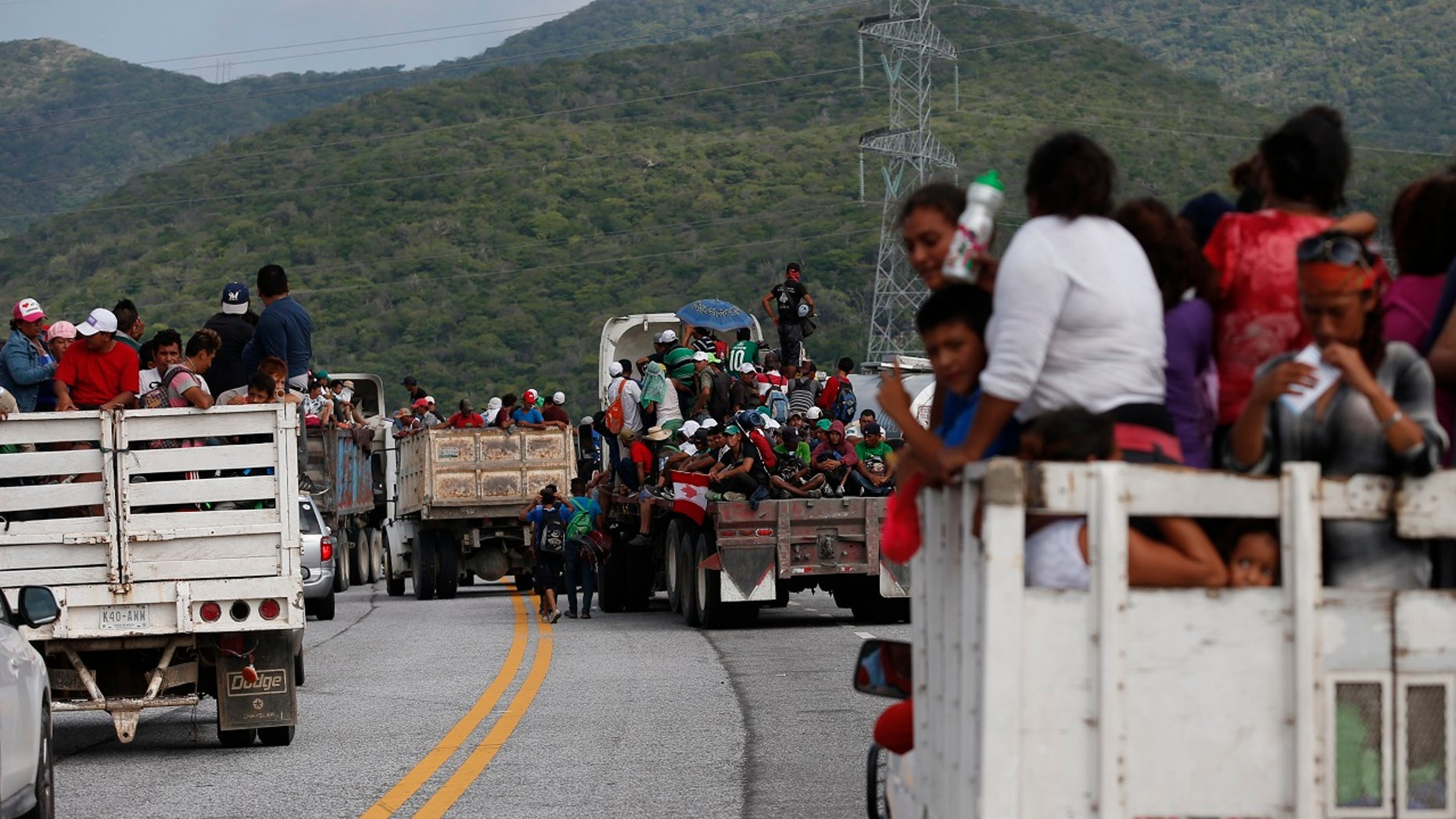 Migrants hitch rides in the back of trucks as the thousands-strong caravan of Central Americans hoping to reach the U.S. border moves onward from Juchitan, Oaxaca state, Mexico, Thursday, Nov. 1, 2018.