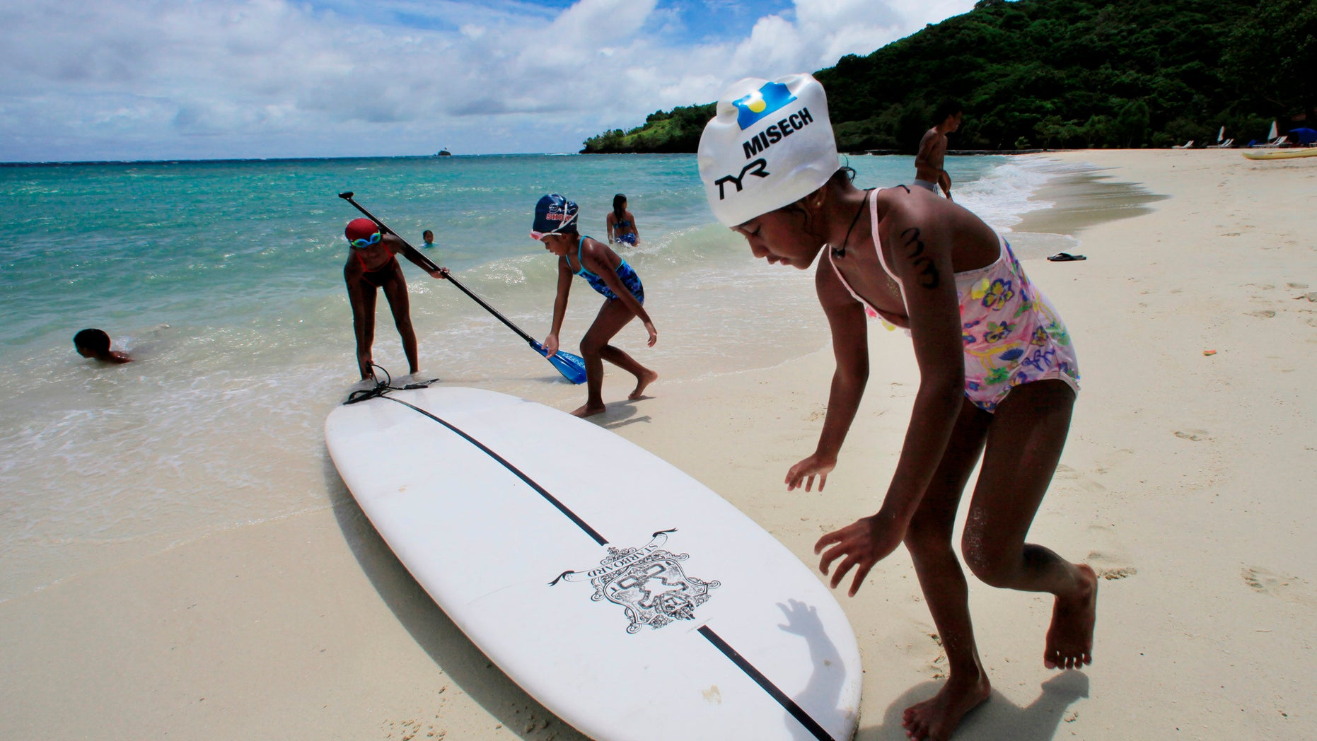 In this June 13, 2009 file photo, children play at a resort beach in Ngerkebesang, Palau.