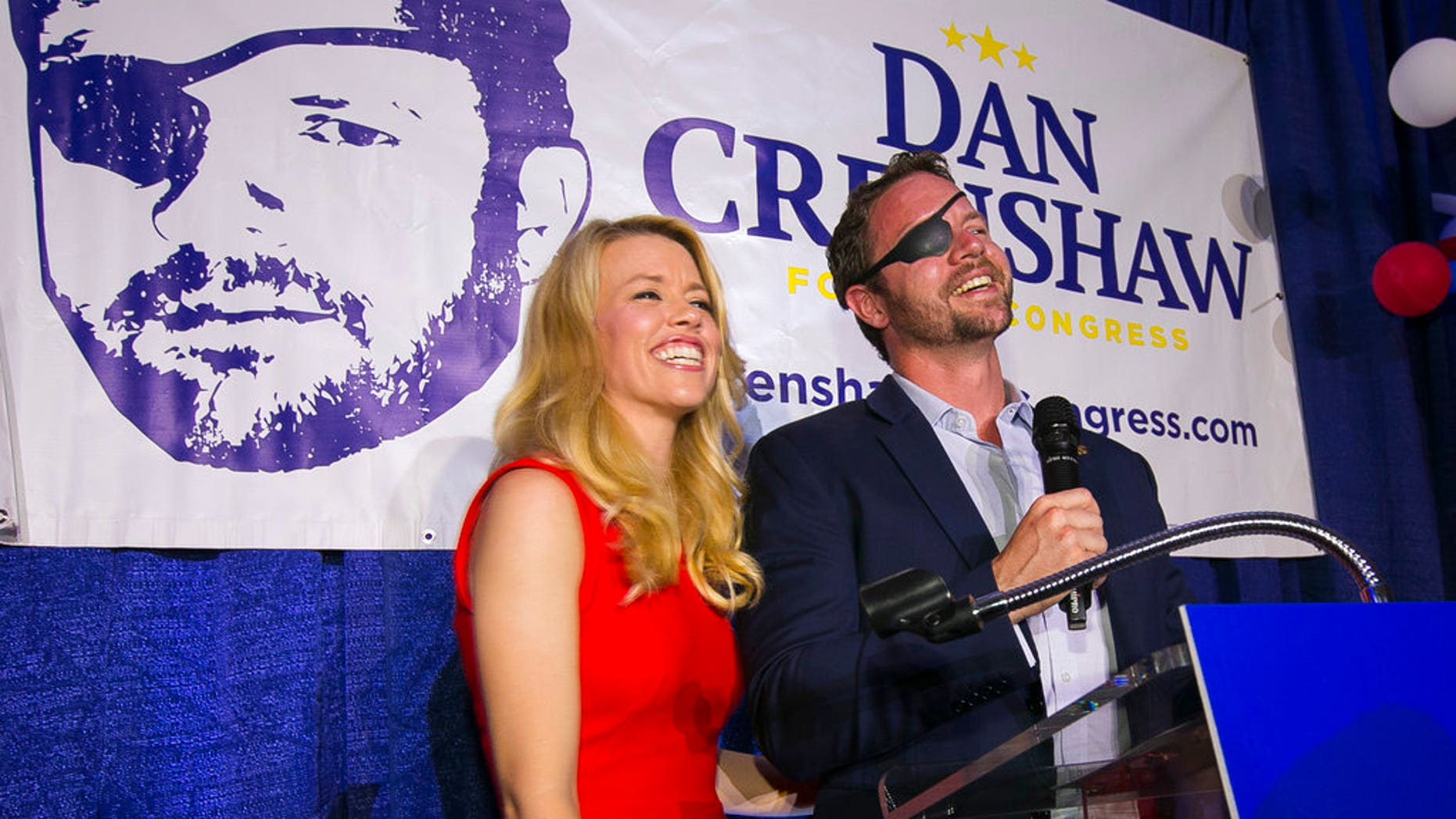 FILE: Republican congressional candidate Dan Crenshaw reacts to the crowd with his wife, Tara, during a party at the Cadillac Bar, in Houston.