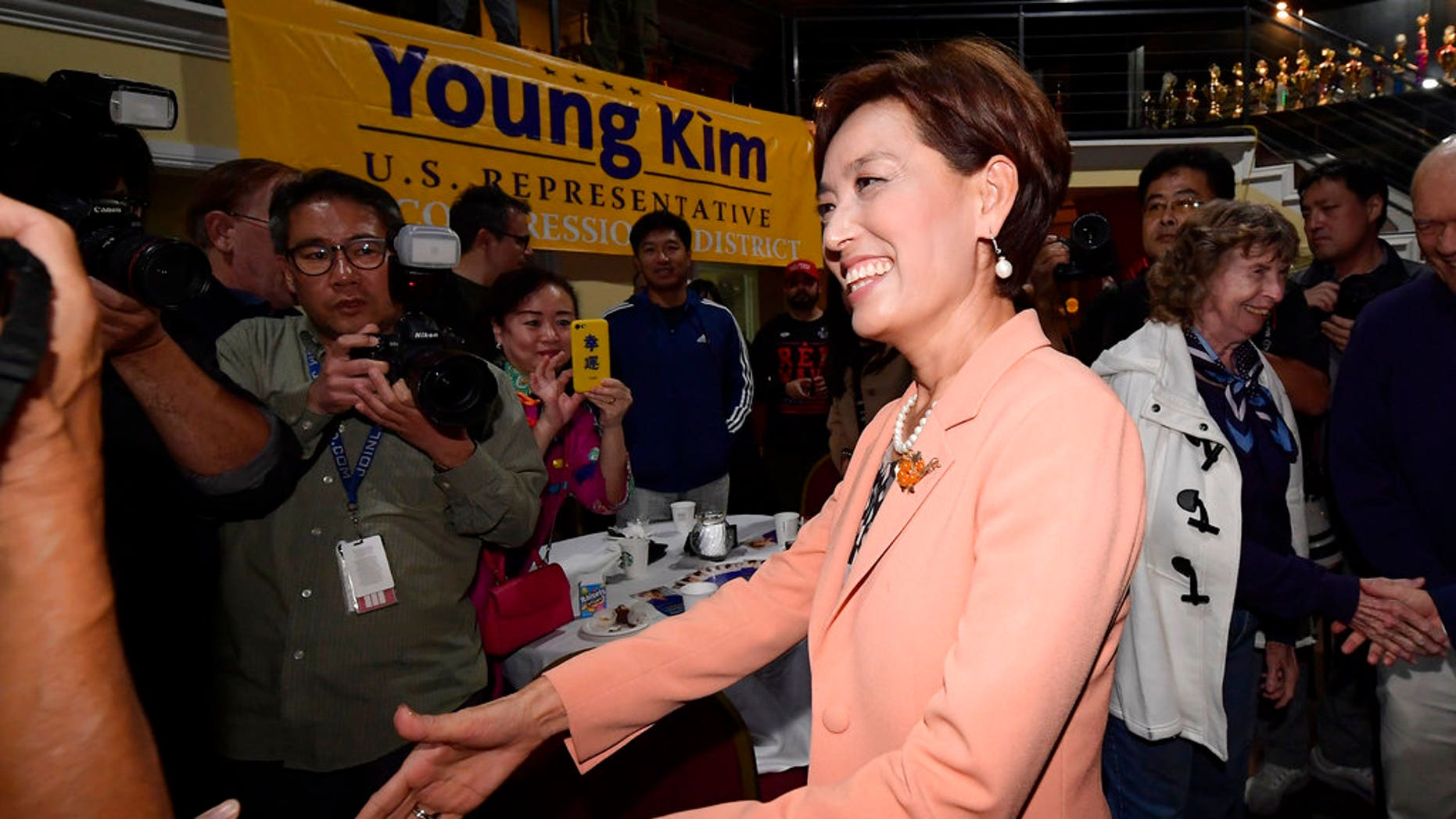 Young Kim, Republican candidate for the 39th Congressional District in California, greets supporters.