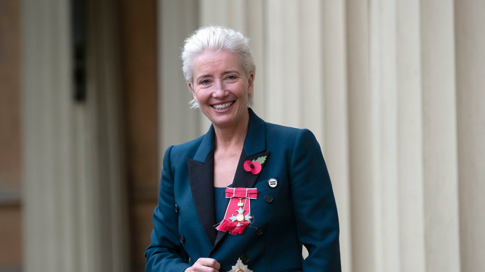 Emma Thompson stands outside Buckingham Palace, London, after being made a Dame Commander of the British Empire by Prince William on Wednesday Nov. 7, 2018.