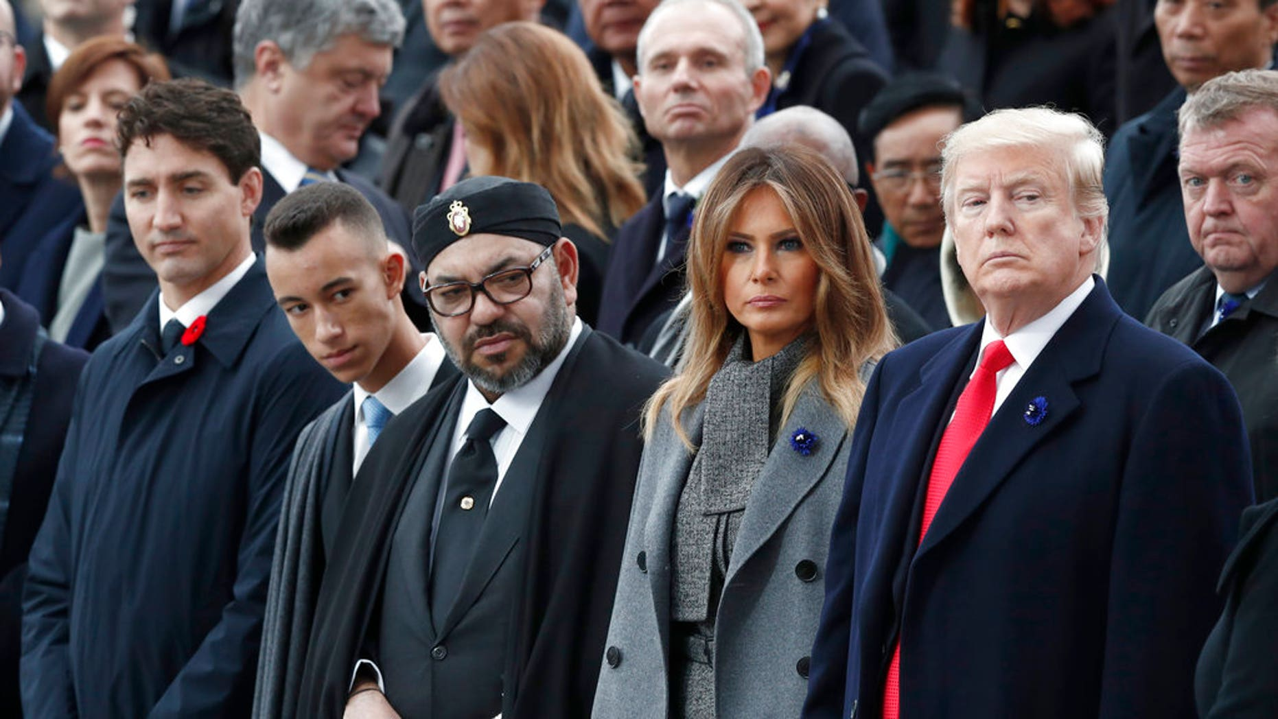 President Donald Trump, first lady Melania Trump, Morocco's King Mohammed VI, his son Crown Prince Moulay and Canadian Prime Minister Justin Trudeau, left, attend a commemoration ceremony for Armistice Day at the Arc de Triomphe in Paris. (AP)