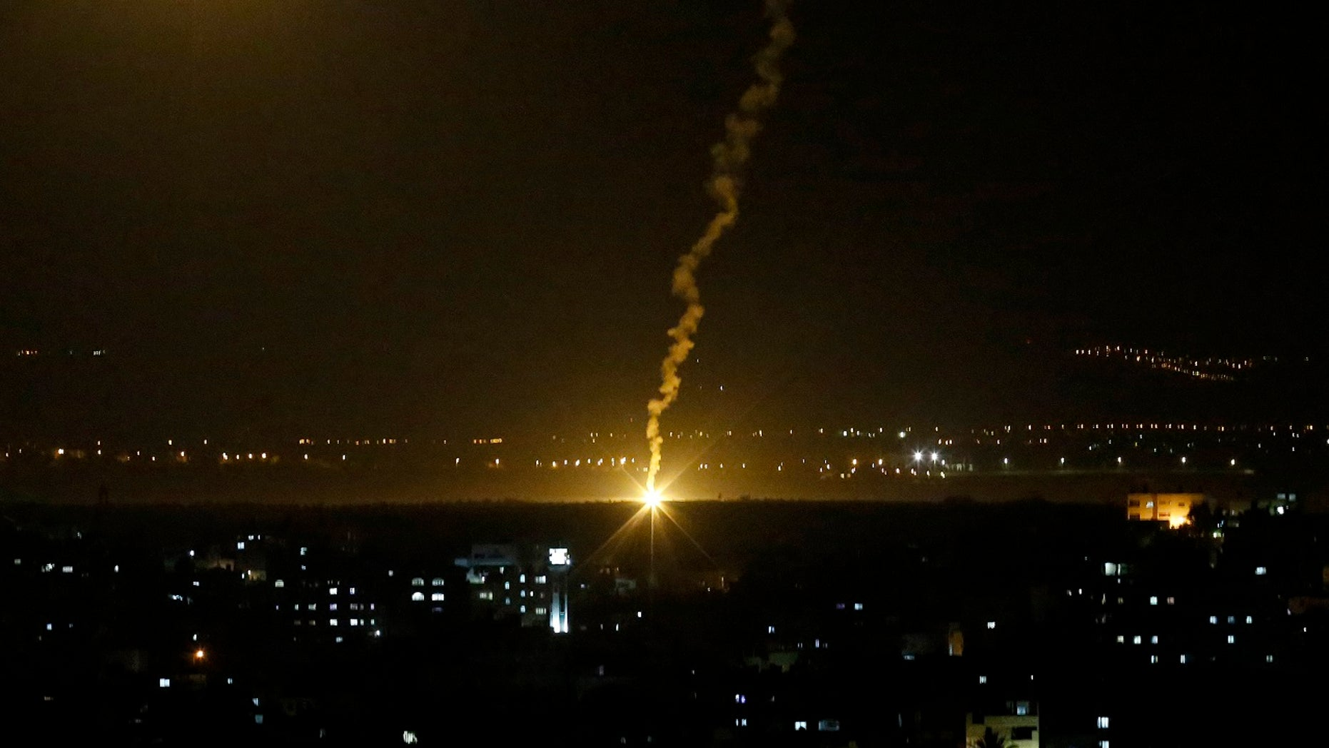 """Flares fired from Israeli forces light up the night sky in Gaza City, Monday, Nov. 12, 2018, as the Israeli military launched fighter jets to strike """"terror targets"""" throughout the Gaza Strip."""