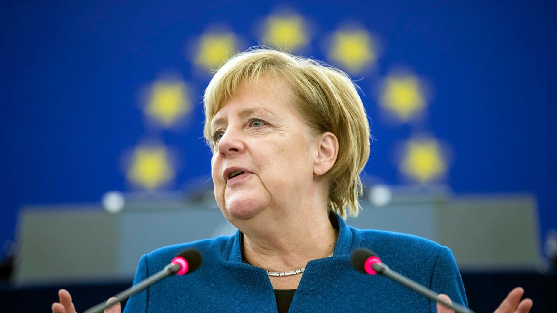 German Chancellor Angela Merkel addresses the European Parliament on Tuesday.