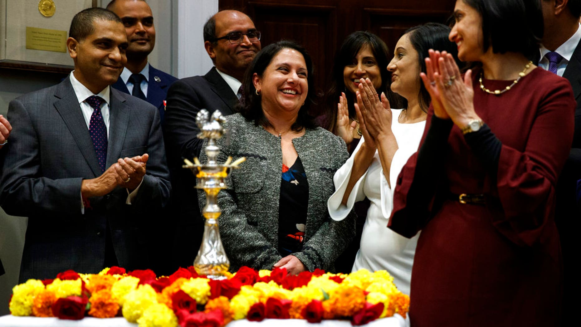 Neomi Rao, Administrator of the Office of Information and Regulatory Affairs, smiles as President Donald Trump announces his intention to nominate her to fill Brett Kavanaugh's seat on the U.S. Court of Appeals for the D.C. Circuit, during a Diwali ceremonial lighting of the Diya in the Roosevelt Room of the White House, Tuesday, Nov. 13, 2018, in Washington. (AP Photo/Evan Vucci)
