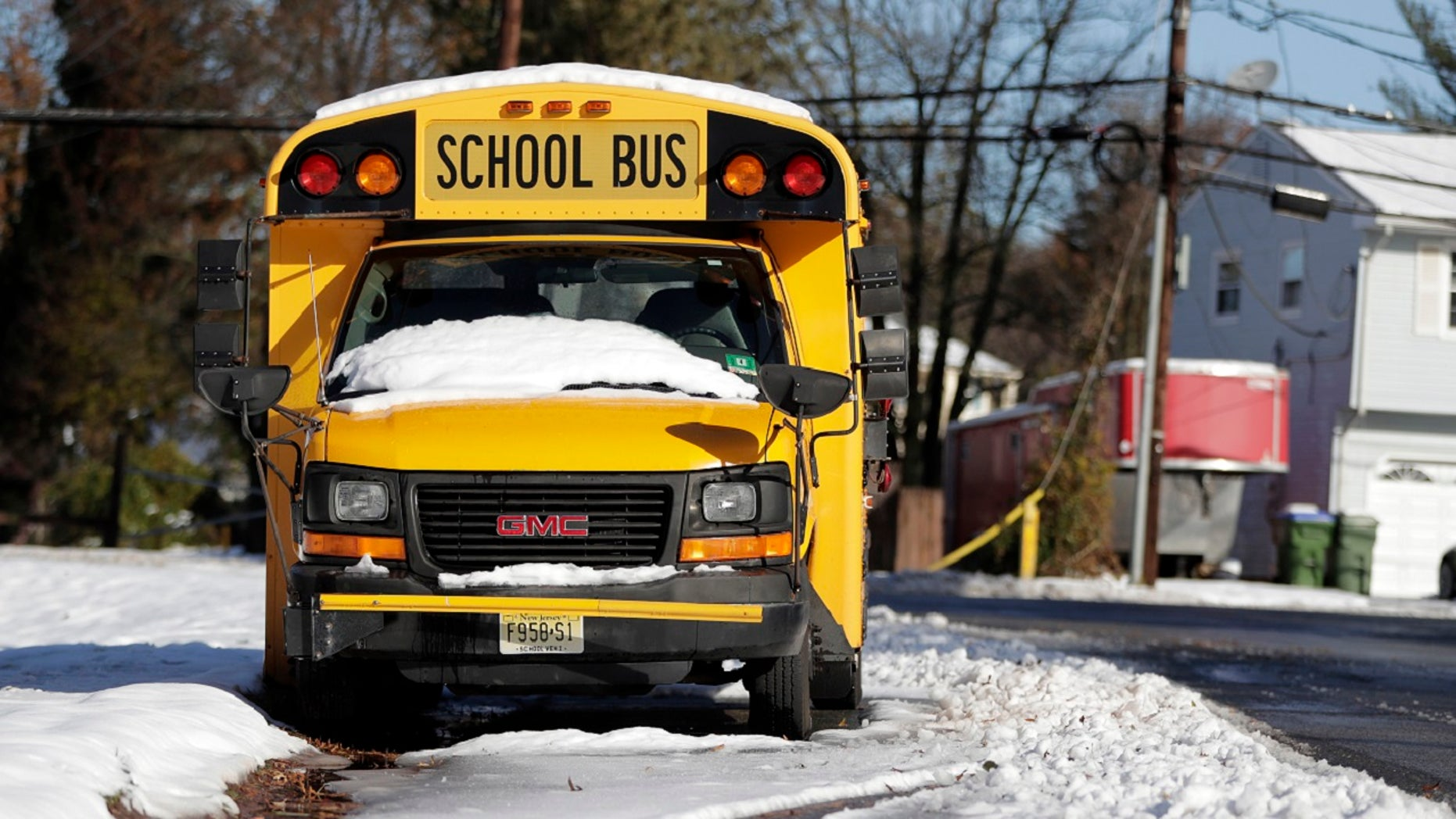 Snow is seen on the windshield of a school bus parked on the side of the street the morning following a snowstorm, Friday, Nov. 16, 2018, in Edison, N.J.