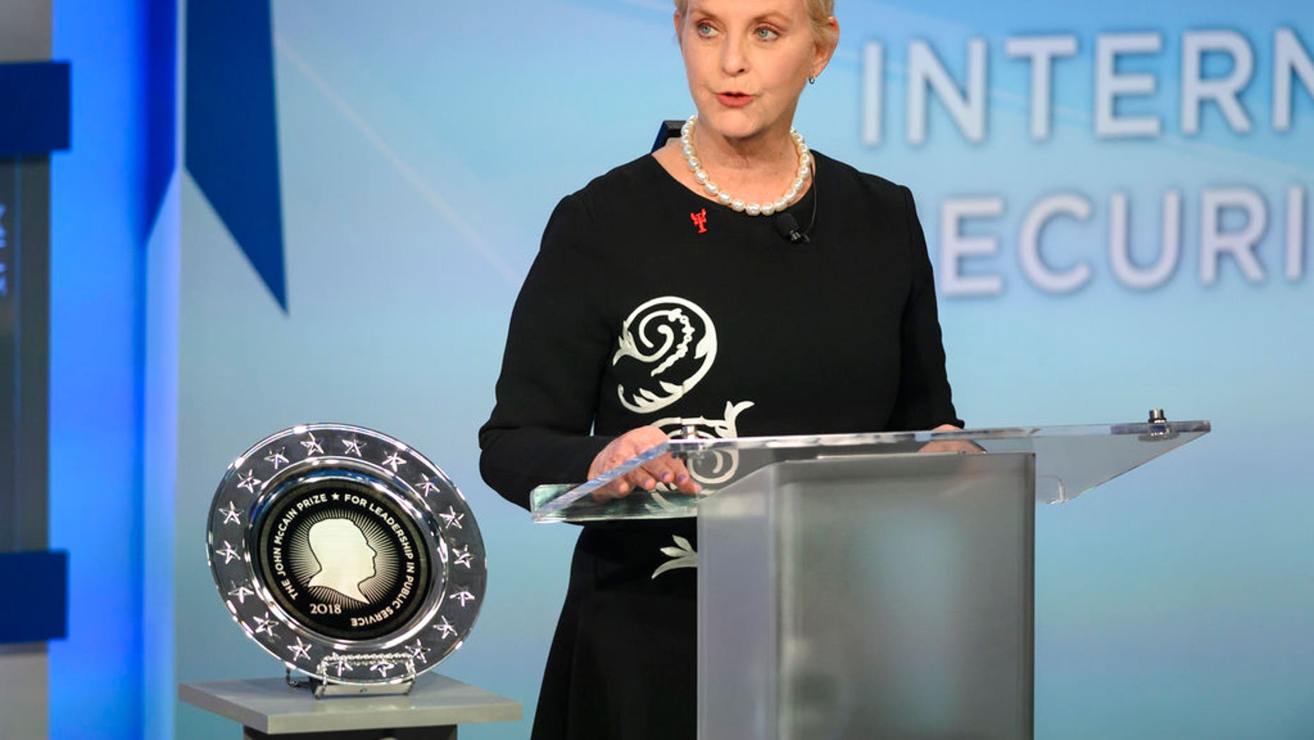 Cindy McCain pauses while presenting the inaugural John McCain Prize for Leadership in Public Service to the People of the island of Lesbos, Greece, at the Halifax International Security Forum in Halifax. (Darren Calabrese /The Canadian Press via AP)