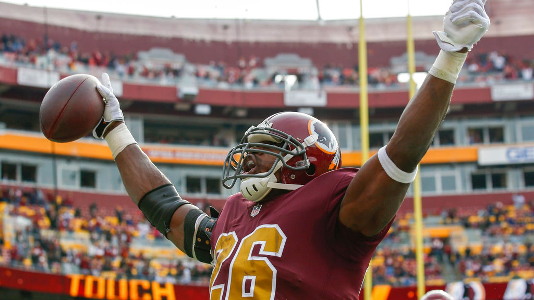 Washington Redskins running back Adrian Peterson (26) celebrates his touchdown during the first half of an NFL football game against the Houston.