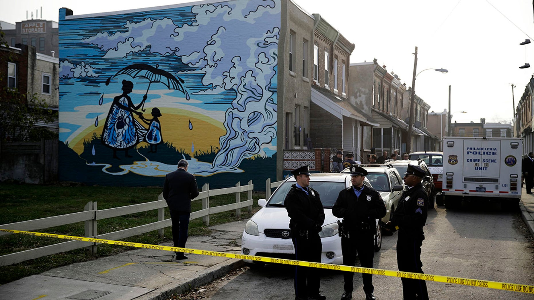 Police gather at the scene of a fatal shooting in the center row home in Philadelphia. (AP)