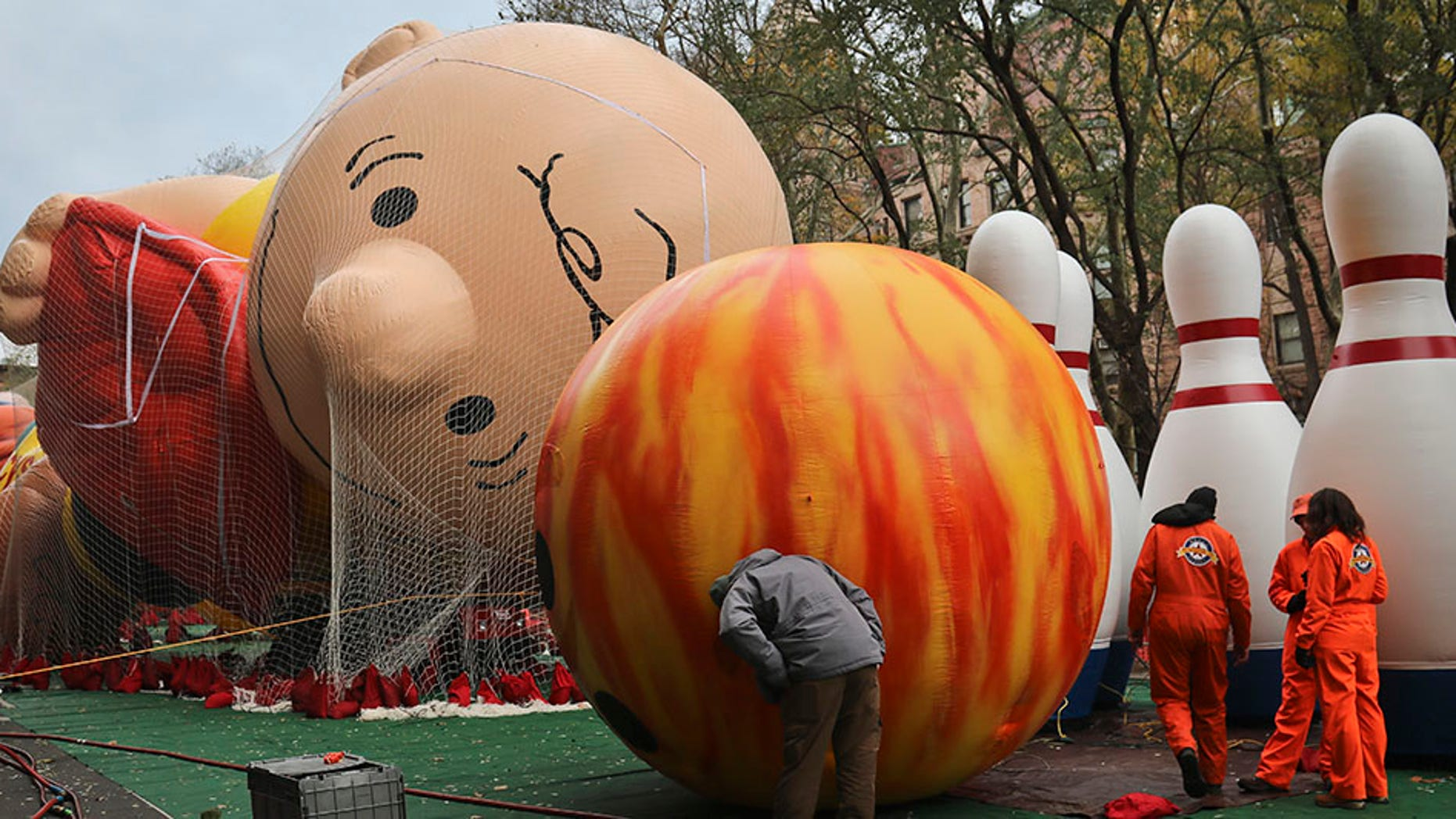 Giant character balloons, including Charlie Brown and Go Bowling, are inflated the night before their appearance in the 92nd Macy's Thanksgiving Day parade, Wednesday Nov. 21, 2018, in New York.