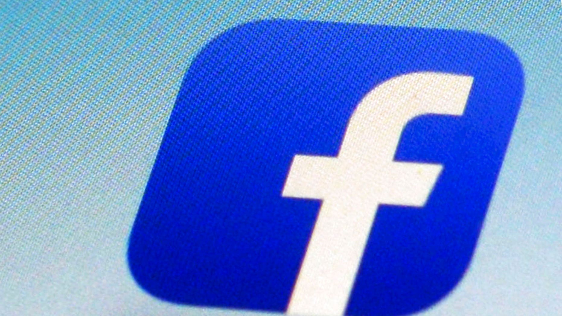 FILE - This Feb. 19, 2014, file photo, shows a Facebook app icon on a smartphone in New York. (AP Photo/Patrick Sison, File)