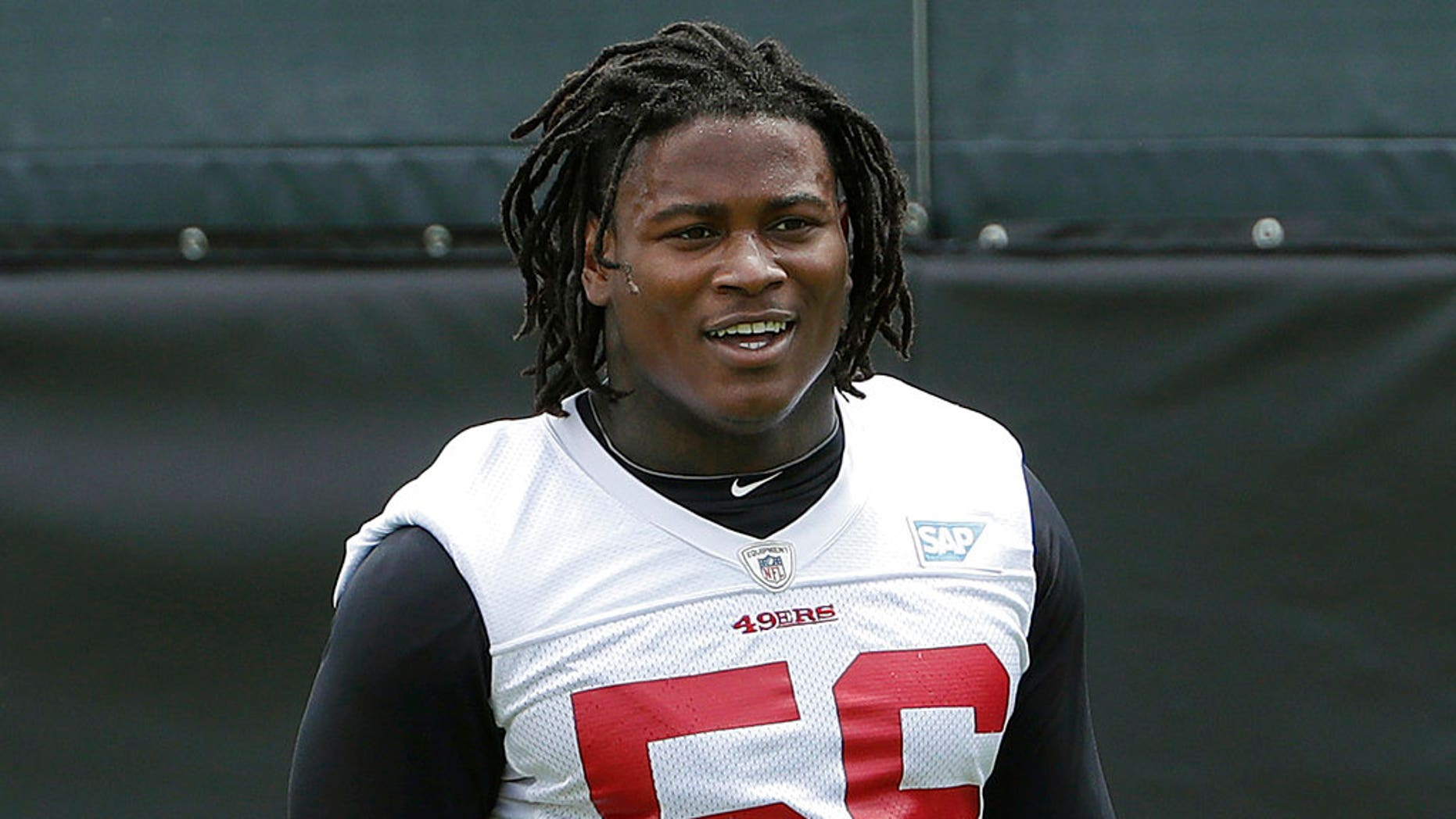 FILE - In this May 30, 2018, file photo, San Francisco 49ers linebacker Reuben Foster walks on the field during a practice at the team's NFL football training facility in Santa Clara, Calif. Foster was arrested Saturday, Nov. 24, at the team hotel on charges of domestic violence.
