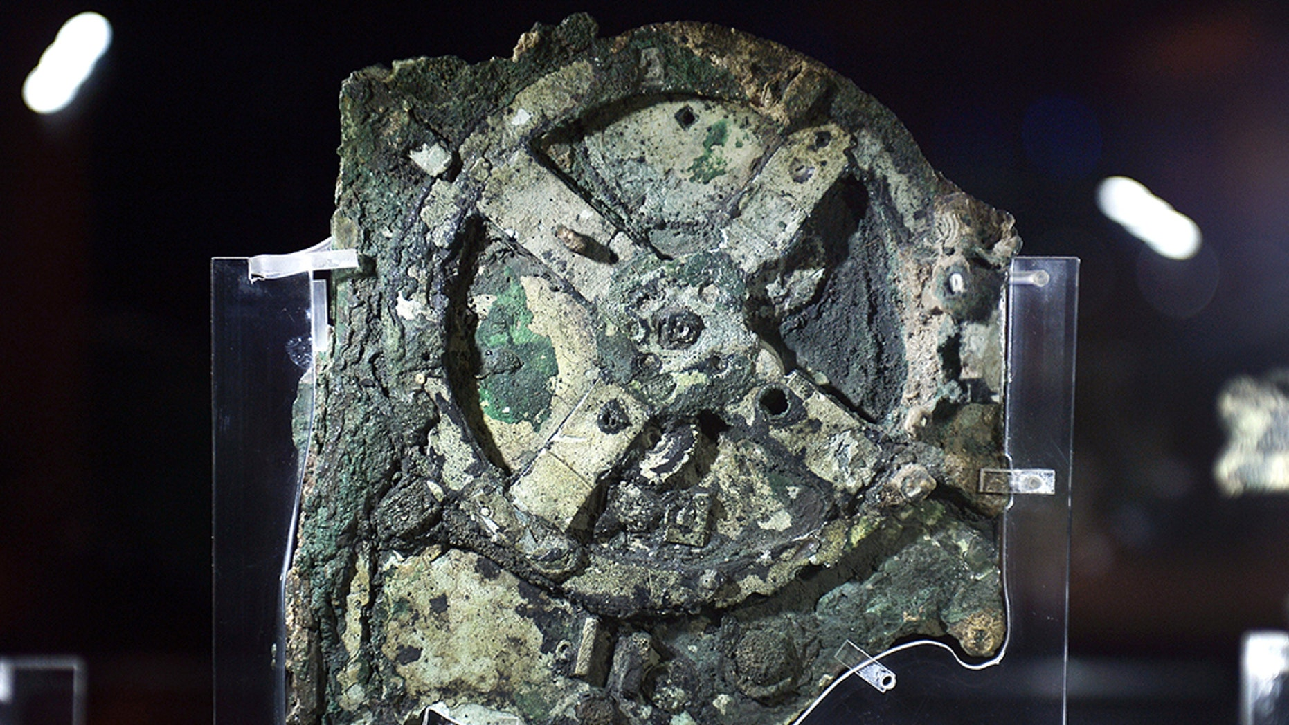 A picture taken at the Archaeological Museum in Athens on September 14, 2014, shows a piece of the so-called Antikythera Mechanism, a 2nd-century BC device known as the world's oldest computer, which was discovered by sponge divers in 1900 off a remote Greek island in the Aegean. The mechanism is a complex mechanical computer which tracked astronomical phenomena and the cycles of the Solar System. AFP PHOTO / LOUISA GOULIAMAKI (Credit: LOUISA GOULIAMAKI/AFP/Getty Images)