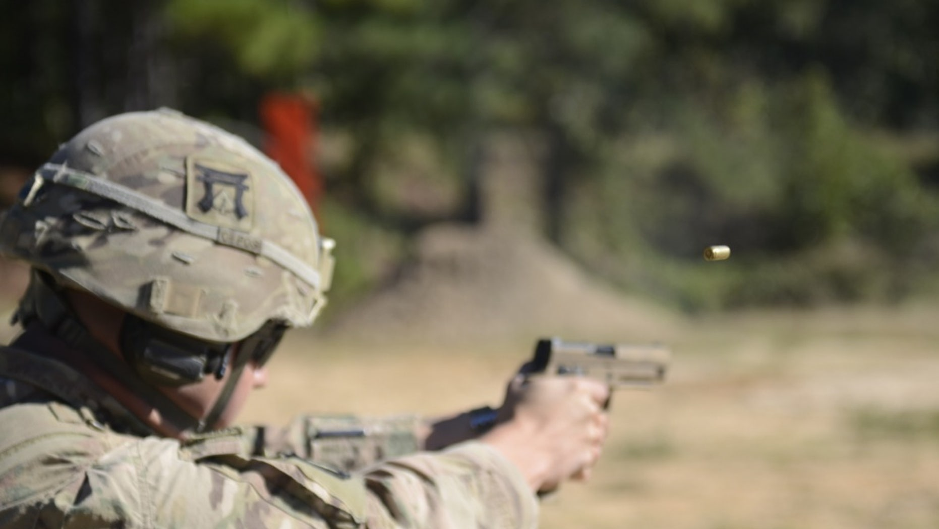 File photo - U.S. Army Cpl. Christopher Crisler, assigned to 101st Airborne Division, fires his M17 pistol at the 25m target in the U.S. Forces Command Small Arms Competition on Fort Bragg, North Carolina, Oct. 22, 2018.